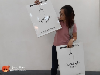 Sip and Gogh provides paper bags to safely secure your masterpiece for transport from their studio. <3